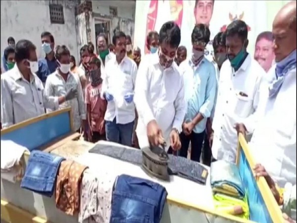 Srikalahasti MLA B Madhusudan Reddy washes and irons clothes at a facilitation programme organised by washermen's union in Chittoor on Tuesday. Photo/ANI