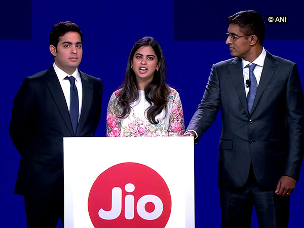 Mukesh Ambani's son and daughter Akash (left) and Isha (centre) along with Jio's President Kiran Thomas at Reliance's 42nd Annual General Meeting in Mumbai on Monday. Photo/ANI