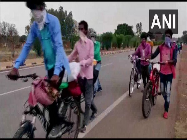 A visual of the migrant workers in Rewa on Saturday while on way back to their native places in West Bengal. Photo/ANI