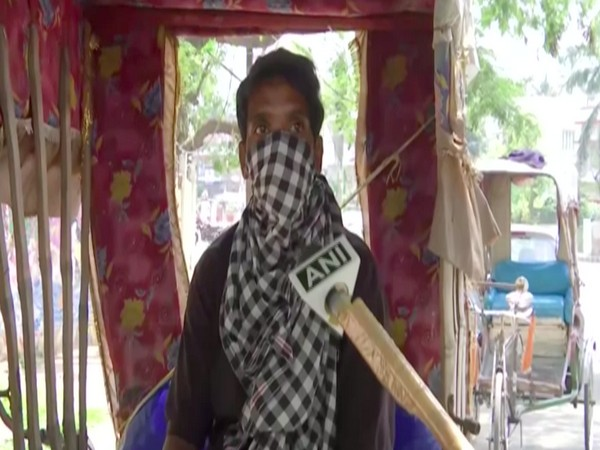 One of the rickshaw-pullers speaking to ANI. Photo/ANI