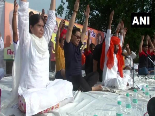 Union Sports Minister Kiren Rijiju performing yoga in New Delhi on Friday.