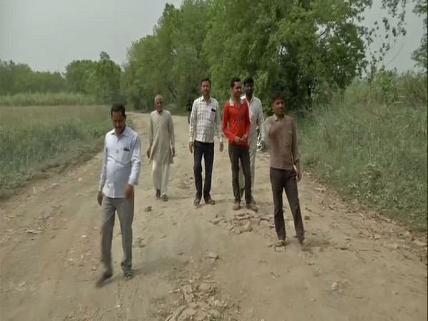 Residents of village Majlis Taufikpur showing bad condition of road connecting their village to other parts of the city