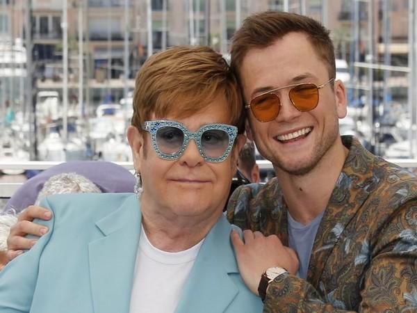 Elton John and Taron Egerton pose during 72nd Cannes Film Festival