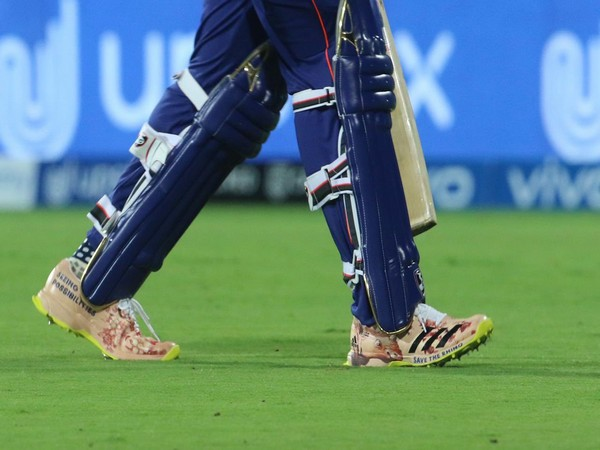 """Rohit Sharma wearing the shoes with """"Save The Rhino"""" written on them (Photo/ Kevin Pieterson Twitter)"""