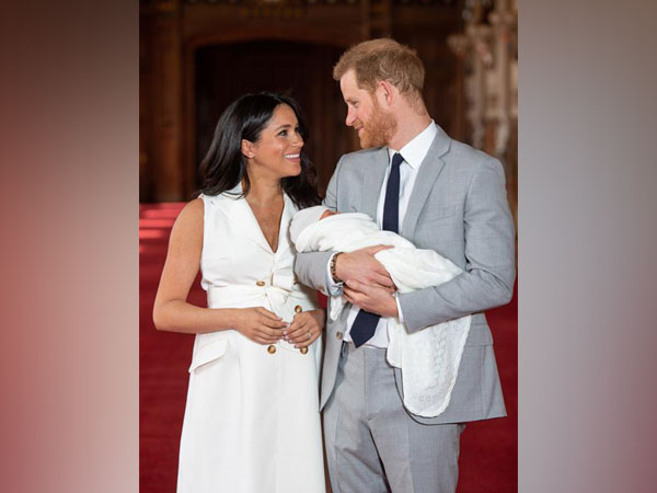 Prince Harry and Meghan Markle with their new born son