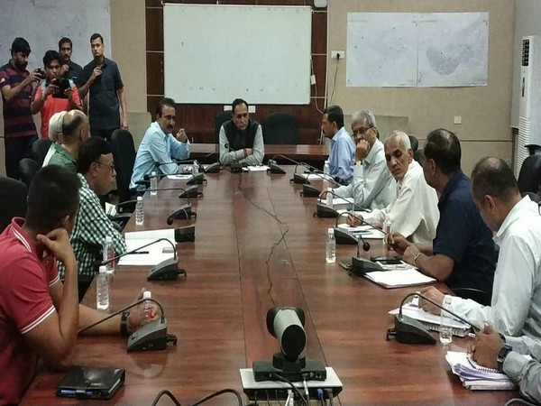 Gujarat Chief Minister Vijay Rupani holding a high-level meeting to review flood-like situation in Vadodara. (Photo/ANI)
