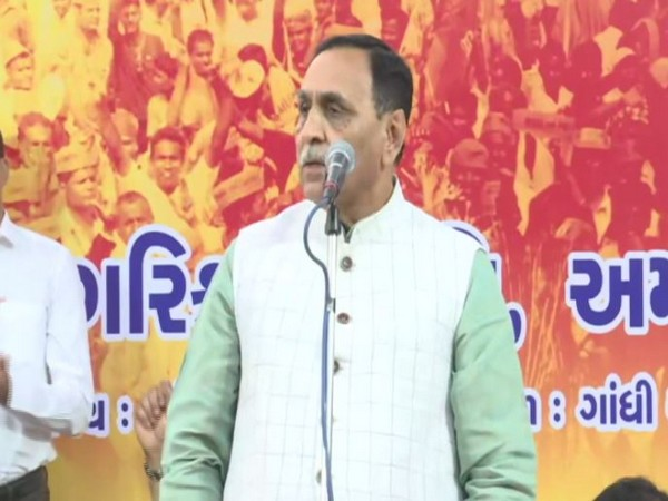 Gujarat CM Vijay Rupani speaking at a public rally in Ahmedabad on Tuesday. Photo/ANI