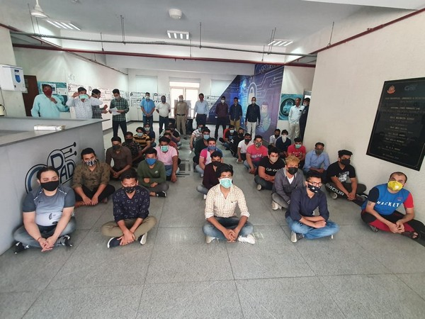 Visuals of the accused held for duping foreign nationals.