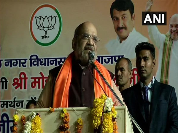 Home Minister Amit Shah speaking at a public meeting in Karawal Nagar, Delhi on Friday.