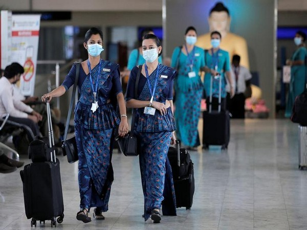 Sri Lankan Airlines staff wear masks at Bandaranaike International Airport