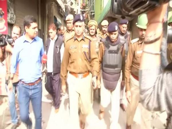 Delhi Police Special Commissioner SN Shrivastava during flag march in North East Delhi's Khajuri Khas area on Thursday. Photo/ANI