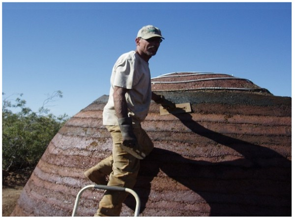 Dr David Stone works on a small domed building made with Ferrock, a material he has been developing as an alternative to Portland cement