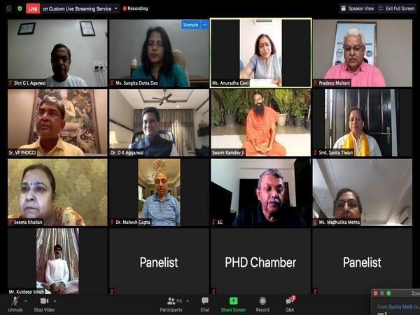 PHDCCI members with Yoga Guru Swami Ramdev during a virtual session on International Yoga Day.