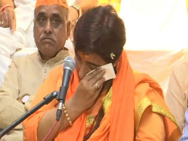 BJP leader Sadhvi Pragya Singh Thakur breaks down while recalling her 'torture' during custody. She was addressing BJP workers in Bhopal, Madhya Pradesh, on Thursday. Photo/ANI