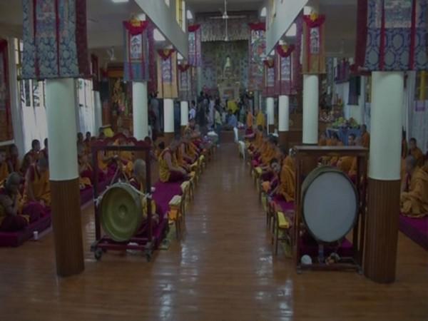 Monks in Dharamshala offering prayers