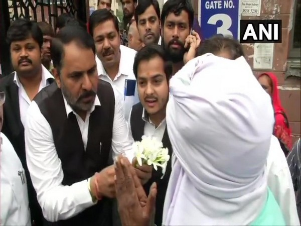 The lawyers at Saket court greet people with flowers on Thursday.
