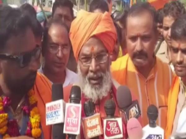 BJP MP Sakshi Maharaj talking to reporters in Unnao, Uttar Pradesh on Saturday. Photo/ANI
