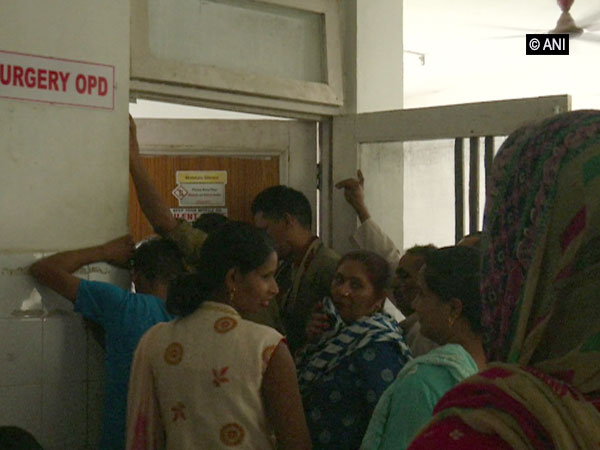 Patients standing in a queue at Samba district hospital. [Photo/ANI]