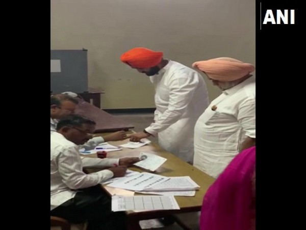 Sandeep Singh (in orange turban) exercising his right to franchise.