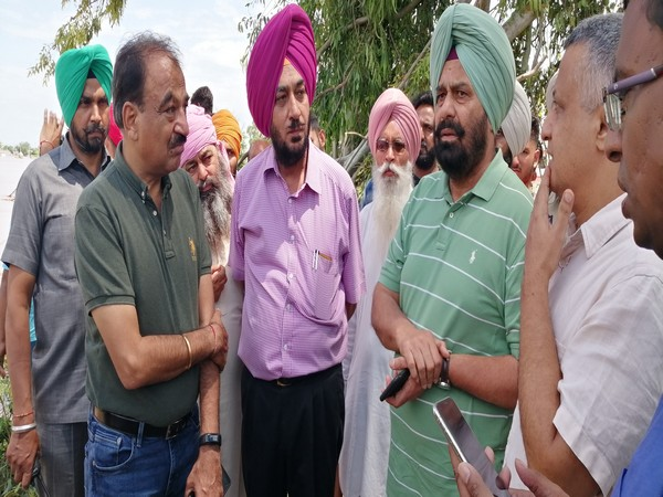 Punjab Water Resources Minister Sukhbinder Singh Sarkaria (3rd from left),  inspecting the flood-like situation in Ropar, Phillaur. Photo/ANI
