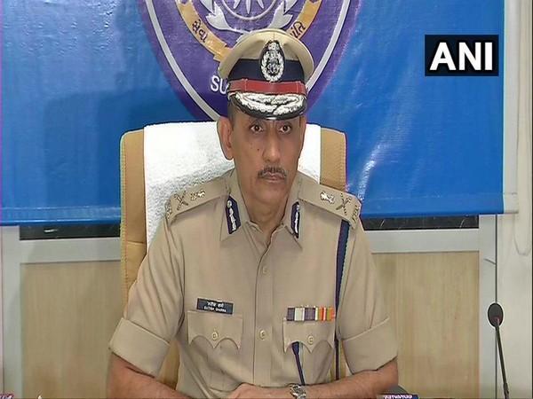 Commissioner of Police Surat Satish Sharma addressing media