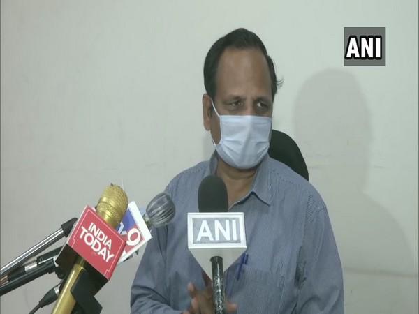 Satyendar Jain speaking to reporters in New Delhi on Saturday.