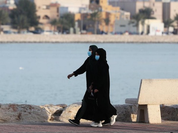 Women wear protective face masks, as they walk, after Saudi Arabia imposed a temporary lock-down on the province of Qatif, following the spread of coronavirus.