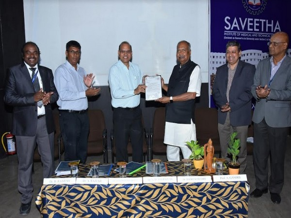 Prof AK Prakash Mittal handing over the autonomous order to Dr NM Veeriyan