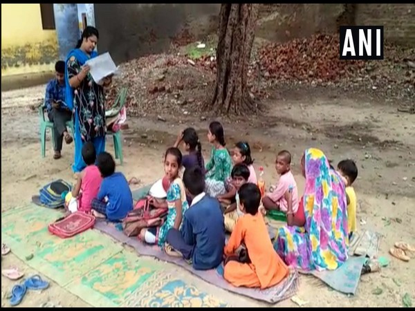 Students of a govt primary school in Shahjahanpur study under open sky due to lack of adequate building infrastructure