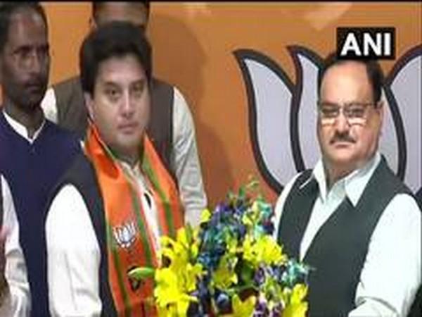 Jyotiraditya Scindia joins BJP in the presence of party president JP Nadda in New Delhi on March 11.