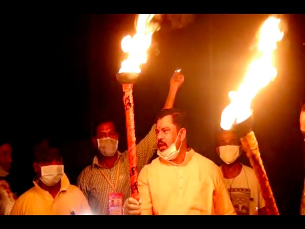 BJP MLA Raja Sigh lights torch in Hyderabad. Photo/ANI