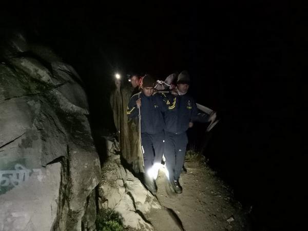The SDRF team bringing the tourist to Gangotri. (Photo/ANI)