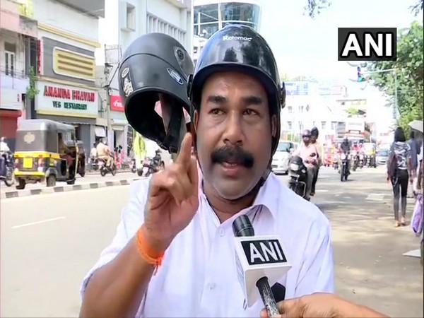 Kerala: Shiv Sena leader protests against implementation of mandatory helmets for pillion riders