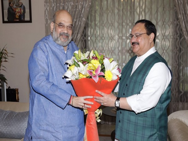 Union Home Minister Amit Shah congratulating BJP President JP Nadda at his residence in New Delhi on Wednesday. (Picture: Shah's Twitter)
