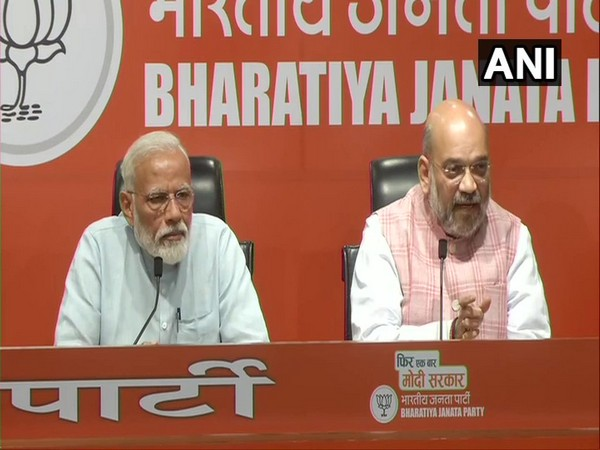 BJP president Amit Shah and Prime Minister Narendra Modi addresses a press conference in New Delhi on Friday.