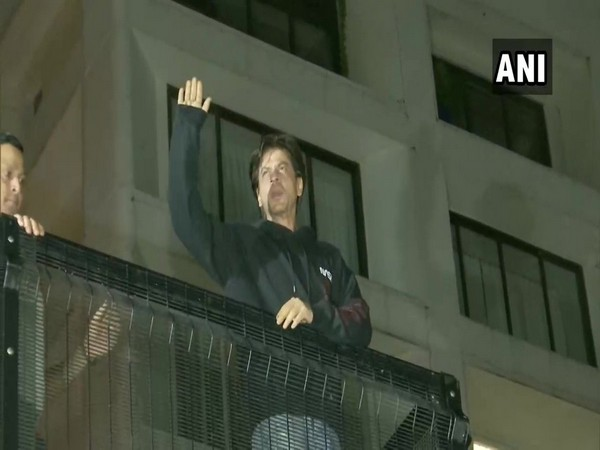 Shah Rukh Khan waves at fans who gathered outside his residence, 'Mannat' on his 54th birthday