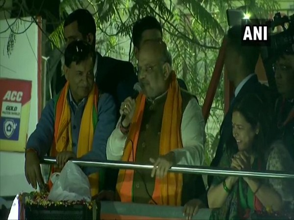 Union Home Minister Amit Shah addressing a gathering during roadshow in Delhi on Tuesday.