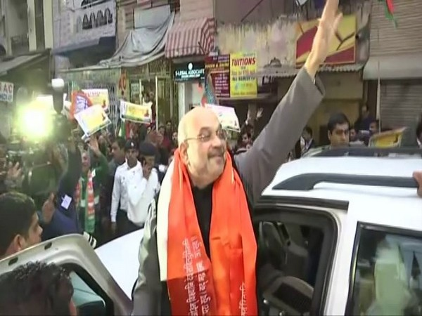 Home Minister Amit Shah visited Amar Colony to meet Afghan Sikh refugees on Sunday as part of awareness campaign conducted by BJP on CAA. Photo/ANI