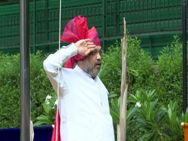 Union Home Minister Amit Shah hoisted the flag at his residence in New Delhi on Saturday. Photo/ANI