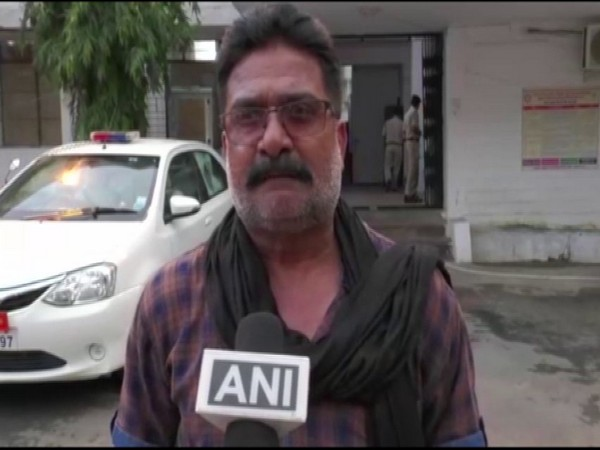 Kanpur encounter main accused Vikas Dubey's brother-in-law, Rajeev Nigam speaking to ANI in MP's Shahdol on Tuesday. (Photo/ANI)