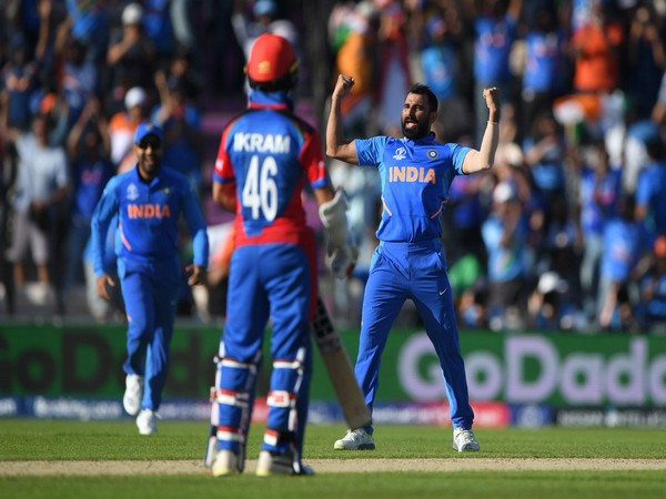 Indian pacer Mohammad Shami celebrating after taking wicket
