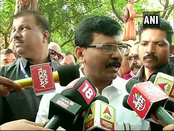 Shiv Sena leader Sanjay Raut speaking to reporters in Mumbai on Sunday.
