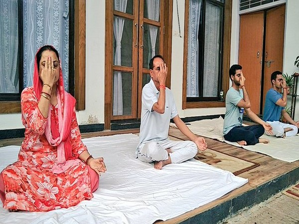 Madhya Pradesh Chief Minister Shivraj Singh Chouhan practices yoga with his family members on International Yoga Day in Madhya Prades on Sunday. Photo curtsy Shivraj Singh Chouhan's Twitter handle