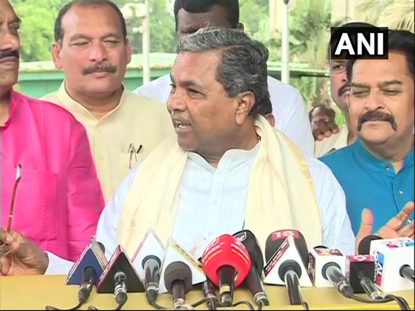 Congress leader Siddaramaiah speaking to reporters on Monday.