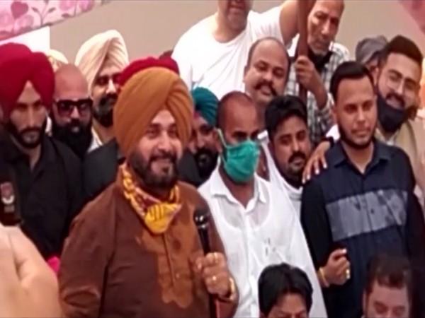 Punjab Congress President Navjot Singh Sidhu addressing party workers in Jalandhar. (Photo/ ANI)