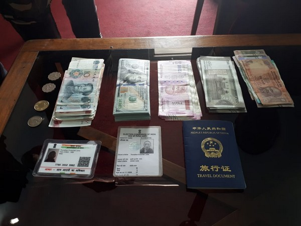 Documents and currency seized by the SSB from the arrested Chinese national.