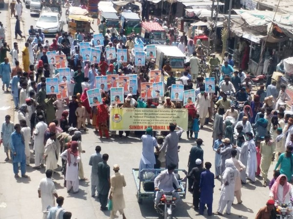 """Protesters carrying slogans saying """"Stop state terrorism, fascism and brutality in Sindh."""" (Photo/ANI)"""