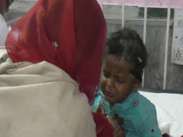 The four year old boy, Bhimaram, with his mother after being rescued from the borewell. Photo/ANI