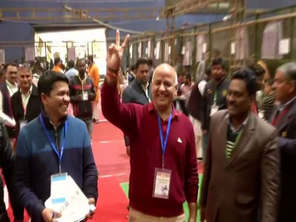 Delhi Deputy CM Manish Sisodia shows victory sign as he leads from Patparganj Assembly seat on Tuesday. Photo/ANI