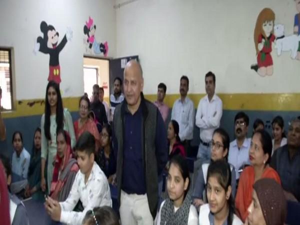 Deputy Chief Minister Manish Sisodia with students of GBSS School at Gokalpur on Wednesday. Photo/ANI